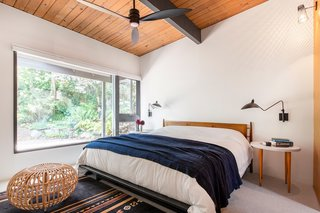 The windows and original wood ceiling were maintained for warmth and light, while the architect's reworked the layout of the master suite.