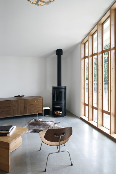A wood-burning fireplace in Stable Conversion creates a sense of home. The project by SHED Architecture + Design is full of light and intended as a flexible space for guests, a home office, or a creative space.