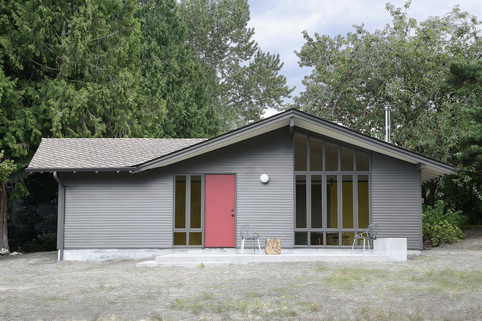 Exterior, Tiny Home Building Type, Shingles Roof Material, Wood Siding Material, and Gable RoofLine What was once a working stable, transformed into a modern refuge for work and play.   Photos from Stable Conversion