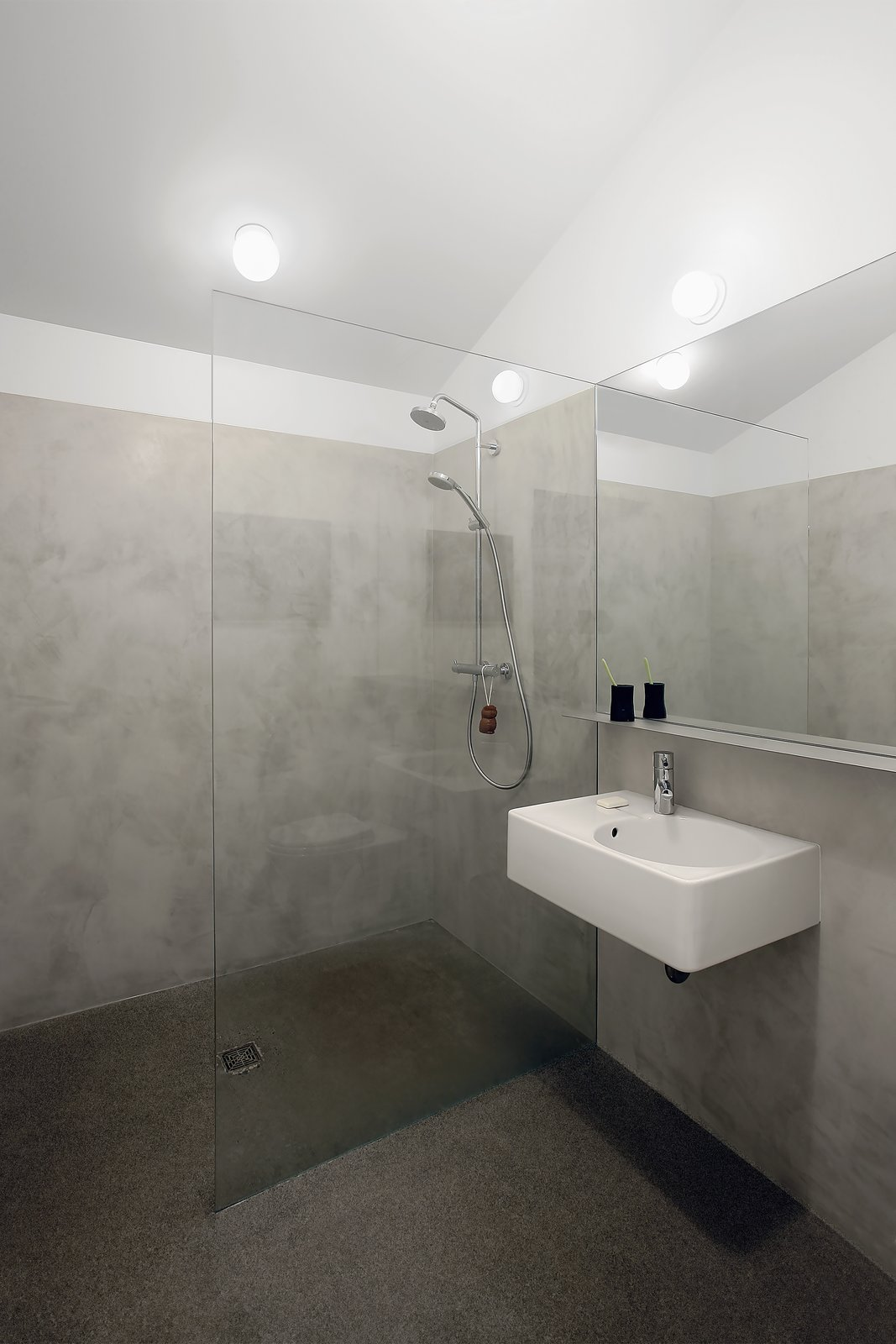 Bath, Wall Mount, Open, Concrete, and Concrete A clean and simple bathroom add to the modern feel of the space.   Bath Concrete Concrete Photos from Stable Conversion