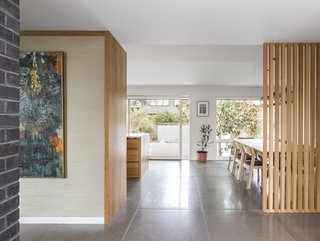 A view from the front door shows that the bright and airy open floor plan leads straight through to the backyard.
