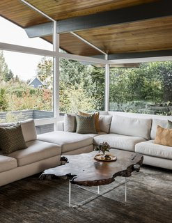 SHED enhanced the original tongue-and-groove ceiling and bold dark beams with new paint and stains. Expansive walls of glass create a strong indoor/outdoor connection.