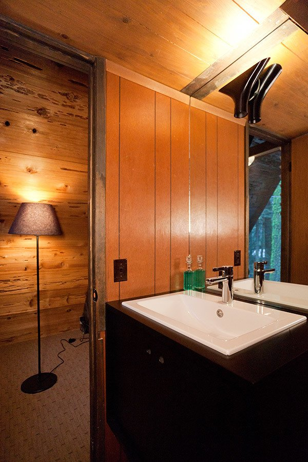 Trees, Front Yard, Small Patio, Porch, Deck, Carpet Floor, Bar, Wood Patio, Porch, Deck, Standard Layout Fireplace, Table, Wood Burning Fireplace, Bed, Wall Lighting, and Bath Room Guest Bath  Homewood by Popp Littrell Architecture + Interiors