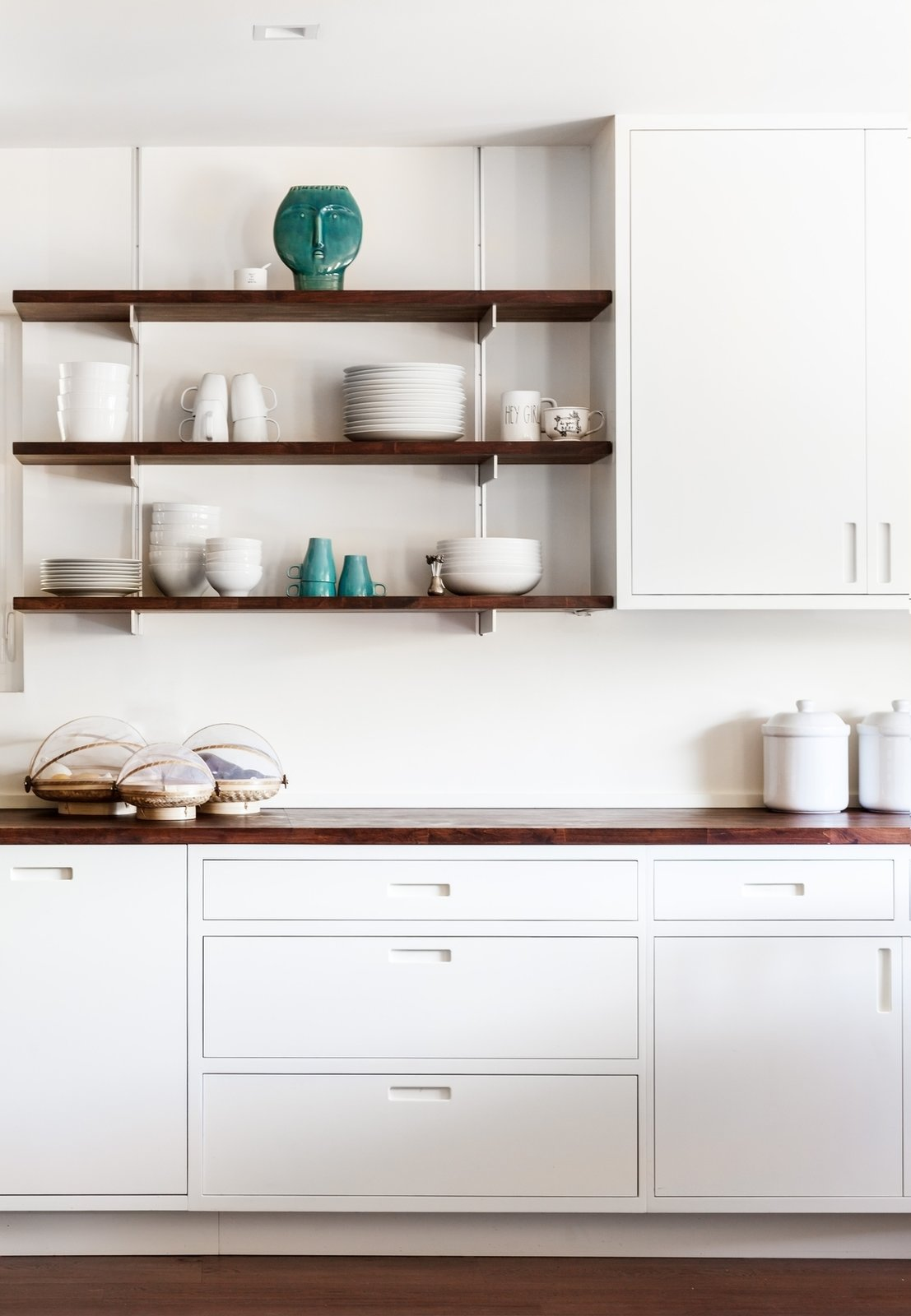 Marble Counter, Wood Counter, White Cabinet, Dark Hardwood Floor, Recessed Lighting, Kitchen, and Open Cabinet Kitchen  Photo 5 of 17 in What's the Most Overlooked Feature When Planning a Kitchen Renovation? from Moss