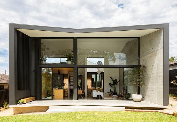 Wall, roof, and floor planes extend the envelope at the rear to form a covered terrace, which also improves privacy from adjacent neighbors and strengthens connection to the home's external environment.
