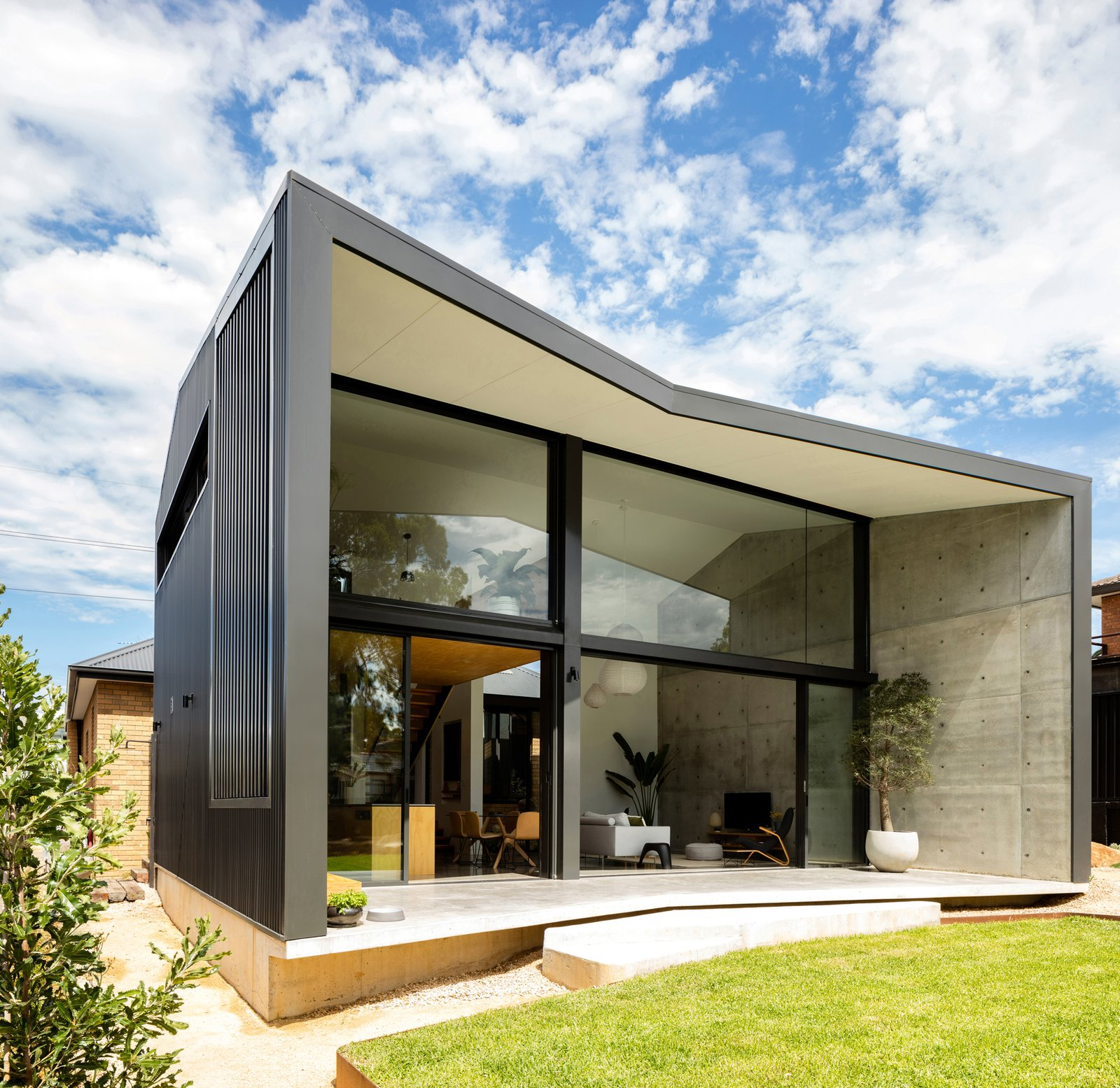 The rear pavilion conceived as an expansive new build sensitively connected to the front 1960's yellow brick original dwelling