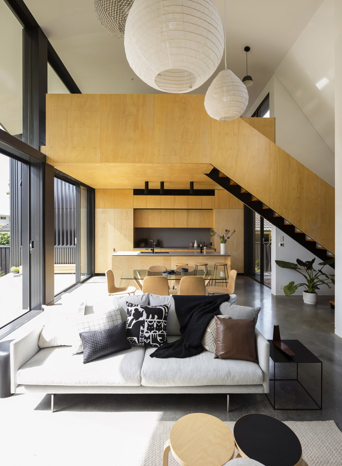 Living areas with two smaller rooms crafted at one end of the pavilion volume - a ground level kitchen and an upper floor sitting room which is flexibly adapted for use as a bedroom and study