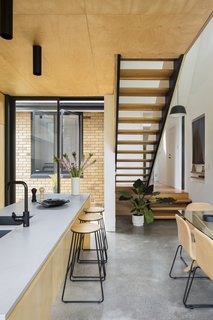 A secondary entry from the northern courtyard into the kitchen with sightlines enabled via an open riser stair across the link towards the front dwelling