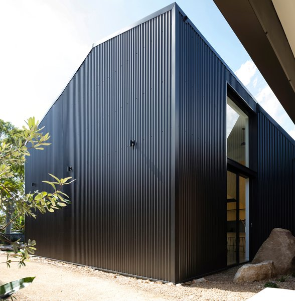"""An opaque southern face mitigates significant overlooking from adjacent neighbors, while enabling a singular """"shed"""" expression aligned to the home's coastal bush-like landscape."""
