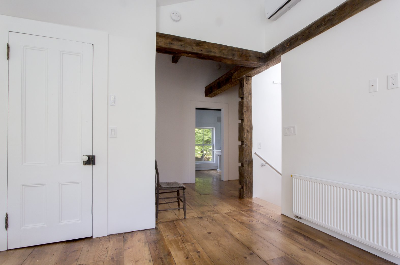 Original wide plank floors and hand hewn beams, once hidden, are now exposed throughout.  twist farmhouse