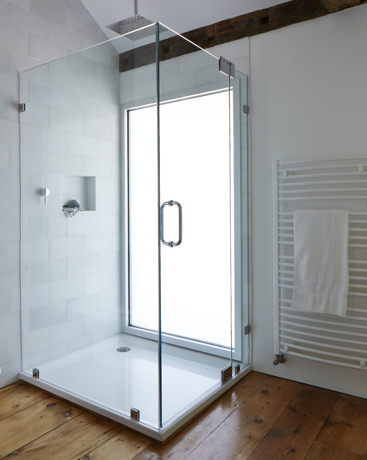 "A window wall of privacy glass illuminates the shower stall, which features a 16"" square stainless steel shower head.  twist farmhouse"
