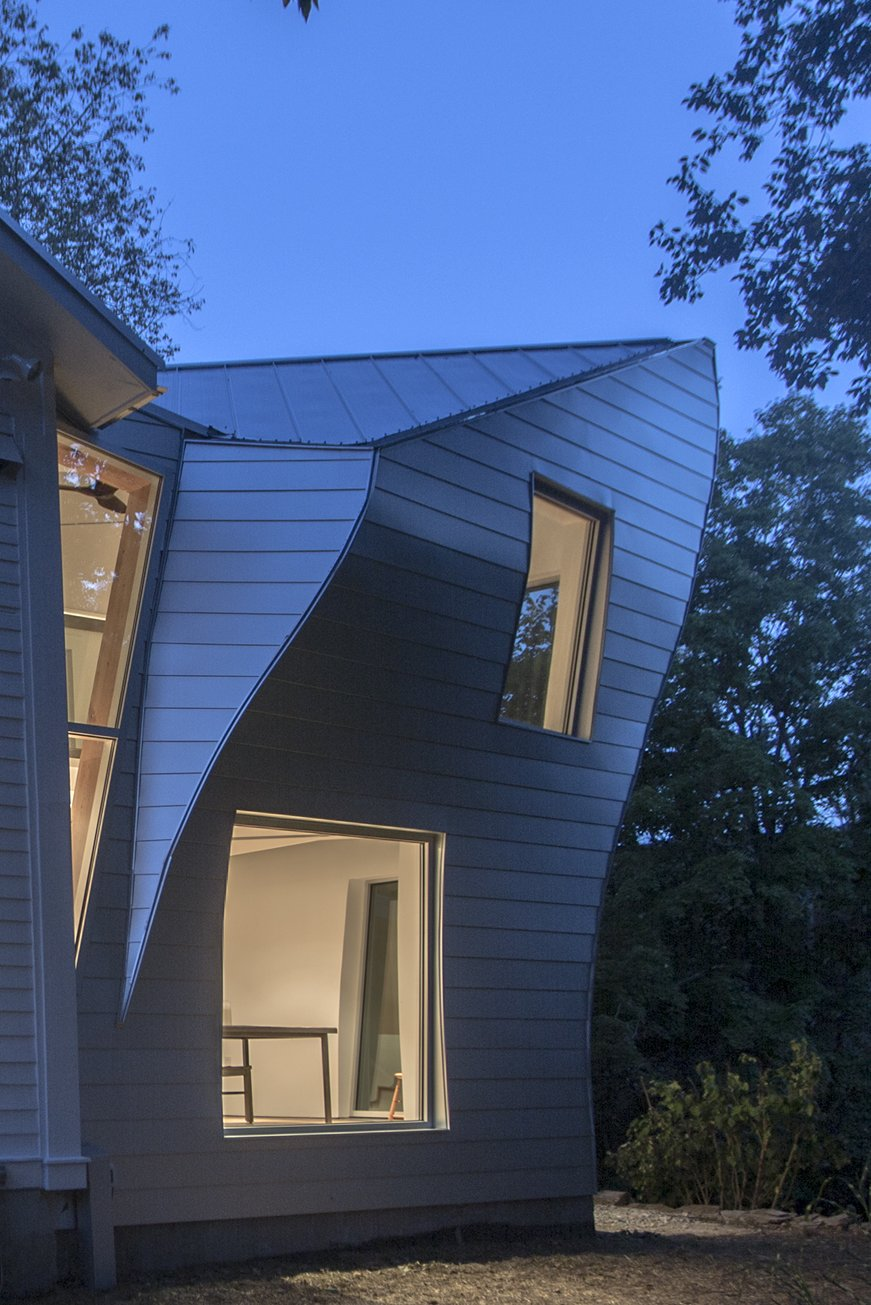 The torquing addition's supple, silvery skin at twilight.   twist farmhouse