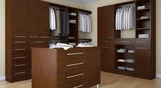 This master walk-in closet would be the perfect addition to a bachelor pad.