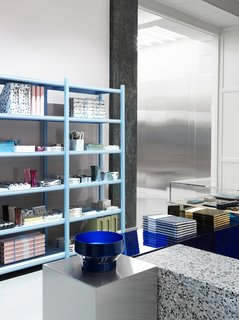The showroom's display podiums are made of mirrored glass, steel, acrylic, and terrazzo.