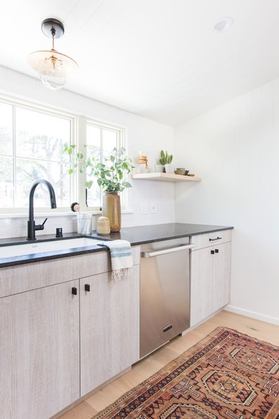 """Designer Amber Lewis's """"No Ordinary Kitchen"""" renovation features a muted palette inspired by clean Scandinavian design. Appliances by Signature Kitchen Suite, such as the dishwasher pictured here, add both style and functionality.  QAC kitchen from Hit Refresh"""