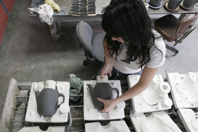 After sitting for about half an hour the clay is firm enough that the cast forms can be removed from the molds. More drying is required before the pieces can be trimmed.  Photo 12 of 36 in Sausalito Dinnerware Factory Tour