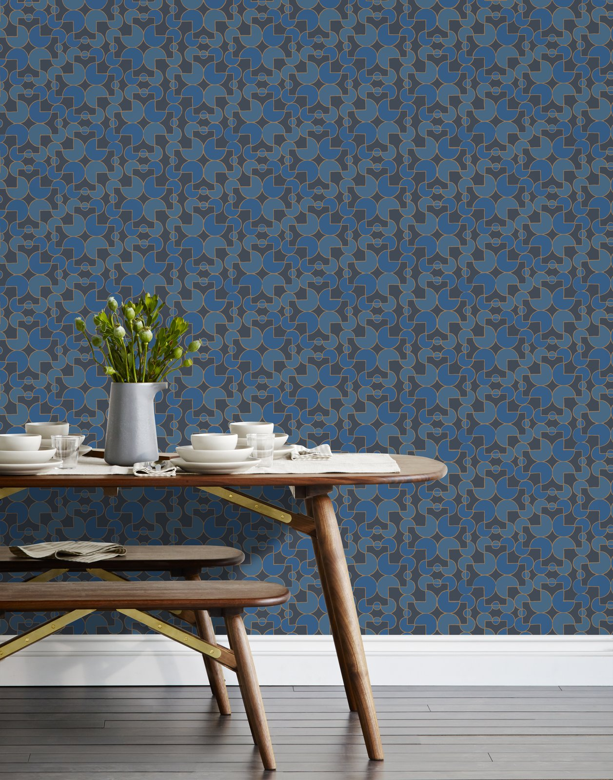 Heath for Hygge & West Wallpaper in Arcade, Navy featured with Dining Table and Benches from Jacob May for Heath: Nomad Collection, and a Heath Clay Studio Limited Editions Vase with Chez Panisse Dinnerware and Native Organics linens.   Pattern from Jacob May for Heath
