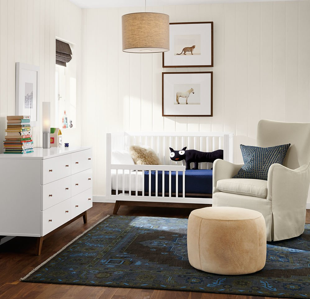 The Ellery swivel glider offers perfectly proportioned comfort for snuggling with your little one. #madeinamerica #nursery #furniture   Photo 6 of 20 in 20 Cool Cribs for the Modern Baby from Modern Kids & Nursery Furniture