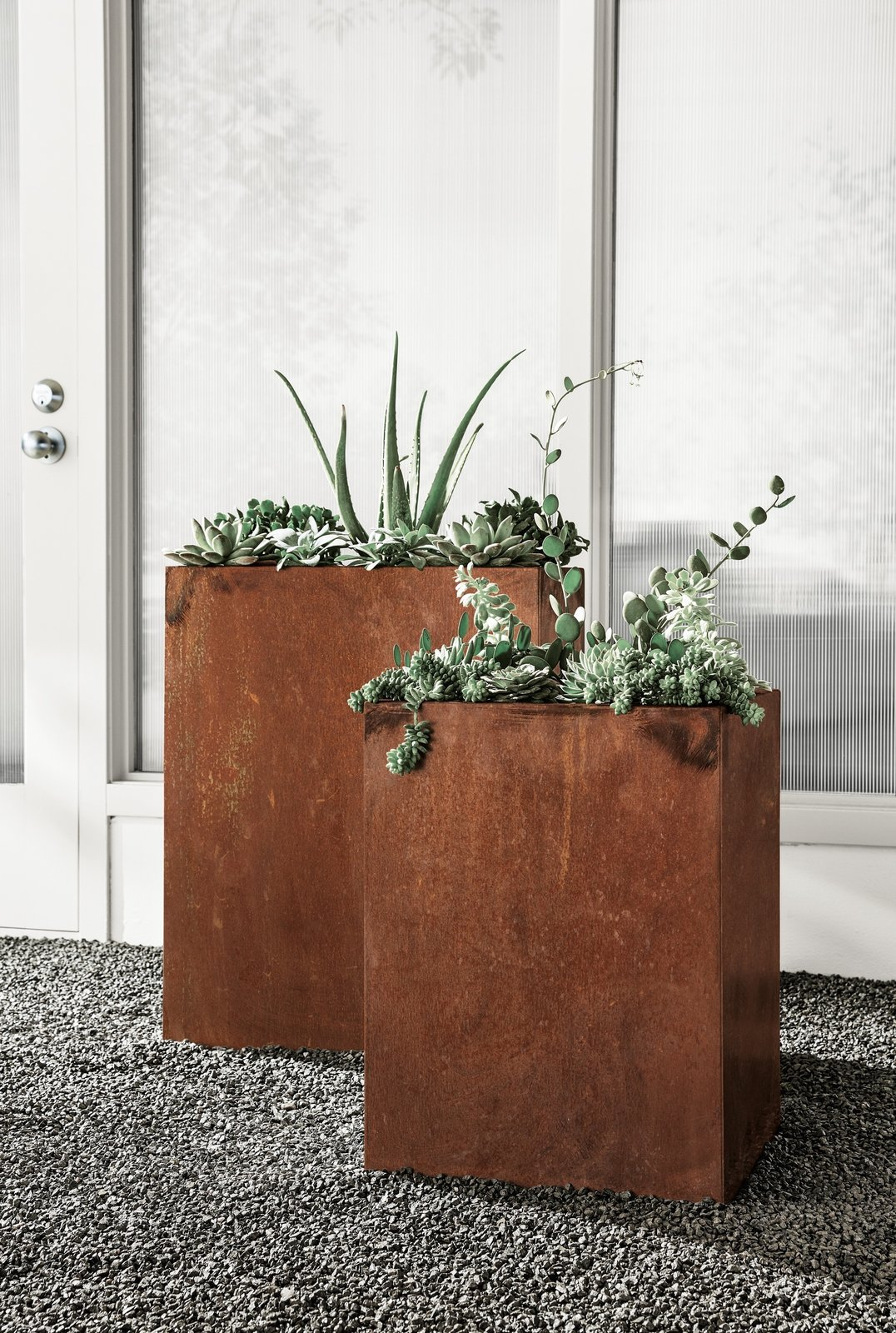 Give your plants a unique home with modern planters made from COR-TEN steel. Often used for bridges or outdoor sculptures, this weathering steel forms a stable, rust-like patina when exposed to the elements. When you receive the planter, it has a shiny appearance that develops a protective layer over time, revealing shades of orange, brown and black. It's a one-of-a-kind, industrial look that adds interest to your outdoor spaces.  20+ Ways to Design with Planters by Allie Weiss from Modern Outdoor Furniture