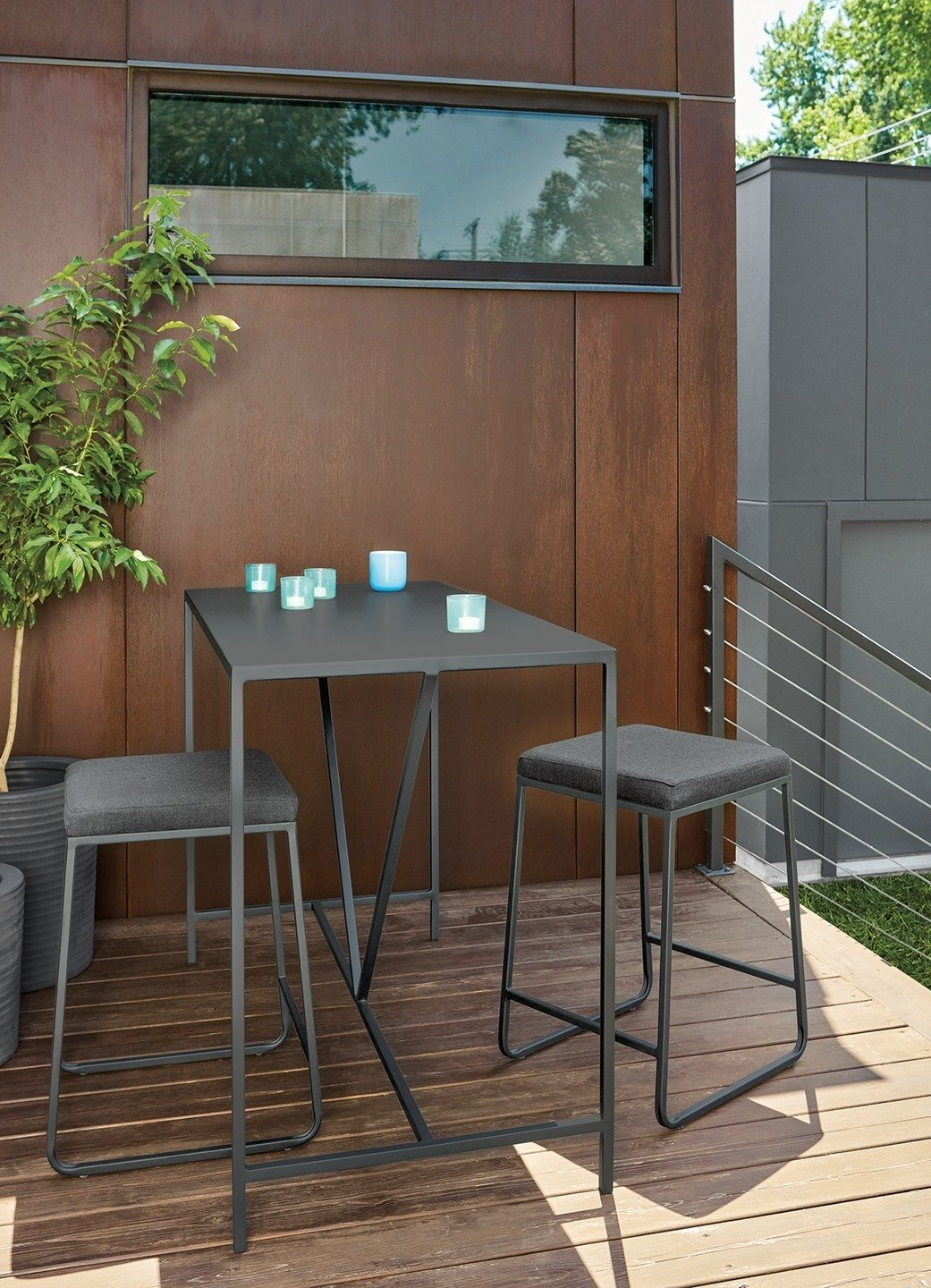 Outdoor, Wood Patio, Porch, Deck, Back Yard, Small Patio, Porch, Deck, and Planters Patio, Porch, Deck Slim counter table, Rollins stools  Photo 5 of 8 in Expert Design Advice: Outdoor Dining Spaces
