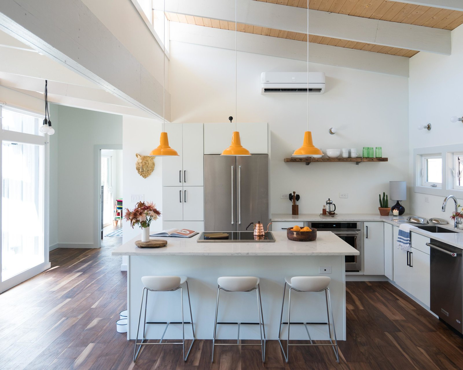 Kitchen, Pendant Lighting, Refrigerator, and Marble Counter Leo counter stools  Photo 2 of 11 in Home Tour: Theron Humphrey of This Wild Idea