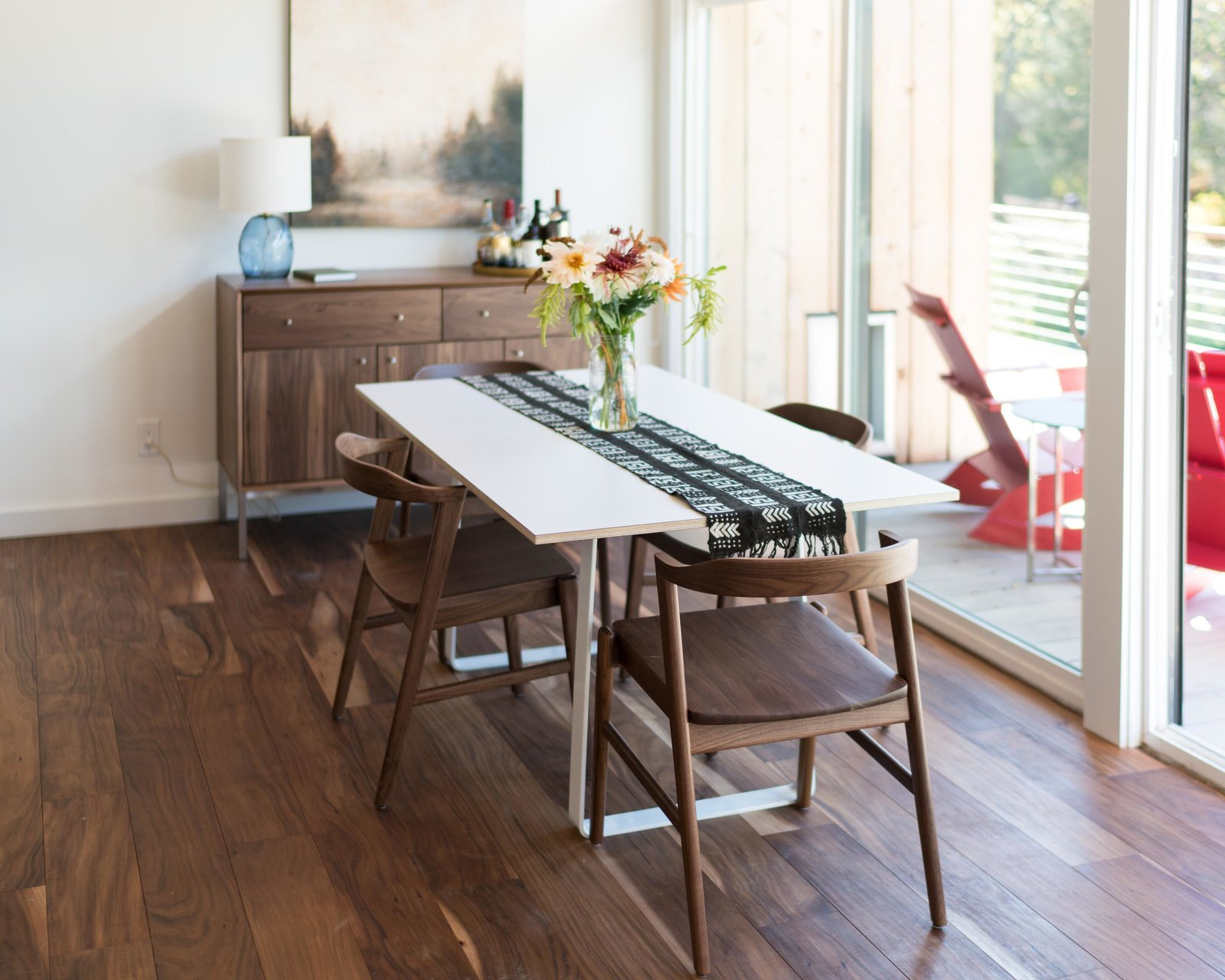Dining Room, Chair, Table, and Medium Hardwood Floor Micah table and Jansen chairs  Photo 6 of 11 in Home Tour: Theron Humphrey of This Wild Idea