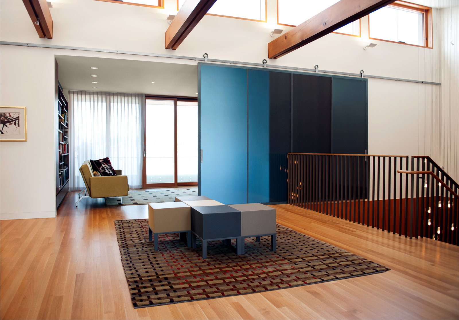 The DECA Architecture team designed a central gallery that connects the main stairwell entry to the dining room and living room.   The CYRK Building