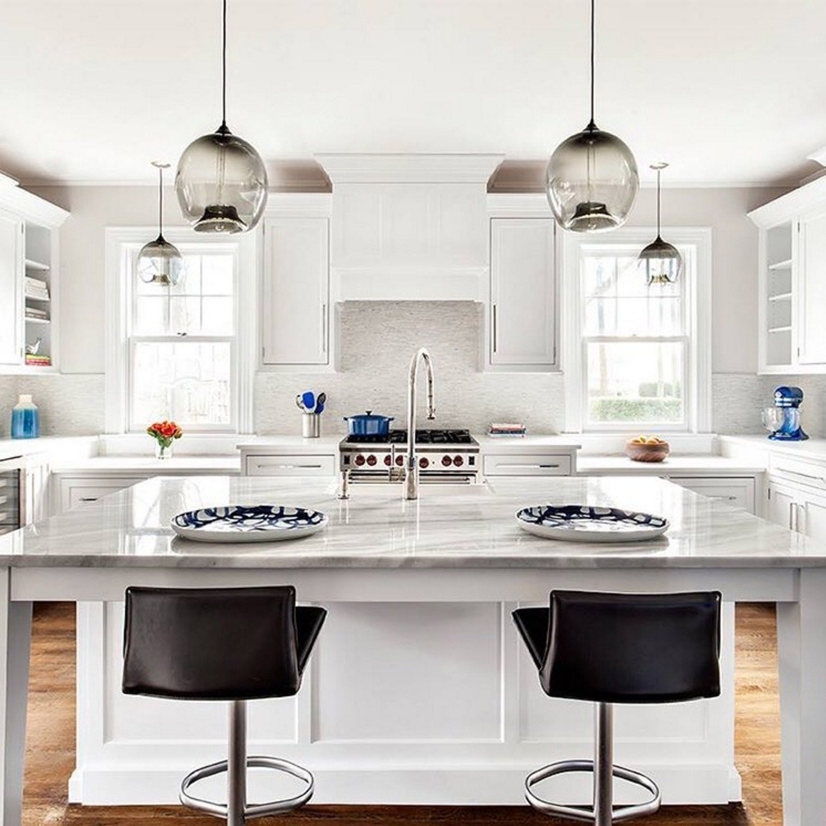 #Kitchen island and kitchen #counter #pendant #lighting come together in this #modern #interior by Clean Design Partners.  60+ Modern Lighting Solutions by Dwell