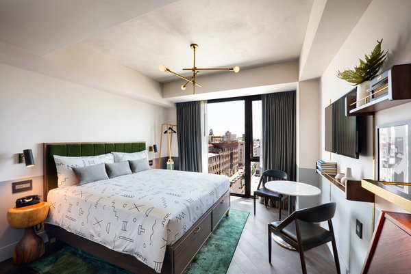 Ennismore Design Studio supplied the rooms with brass fixtures and details, mohair-upholstered headboards, and bedding by Dusen Dusen, a Brooklyn company.