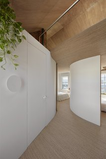 Curved walls define the bedrooms on the second level.