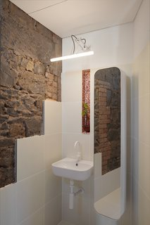 Exposed brick and bluestone in the second-level bathroom.