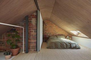 A skylight in the mezzanine creates an airy sleeping area.