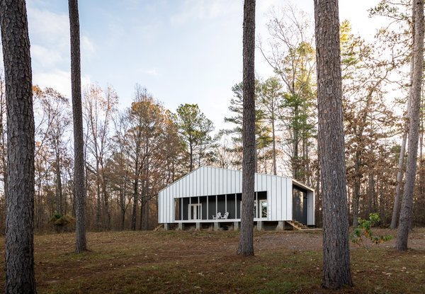 Generations of family have lived on this wooded, waterfront site, where architect Will Randolph has built a weekend getaway for less than $70,000.