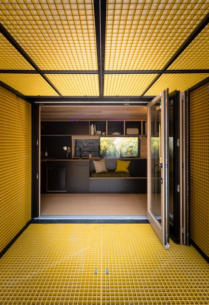 The yellow fiberglass hydraulic panels add a colorful touch to decidedly minimalist interior color scheme.
