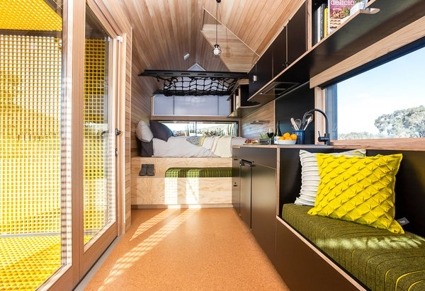 The architects included a built-in bed and bench. The cargo net above the bed acts as a children's area.