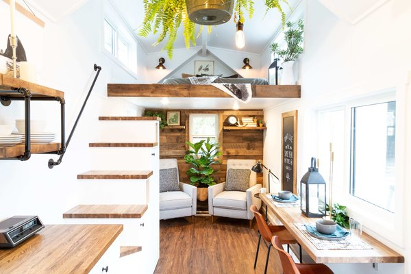 The living room in the Rumspringa model showcases horizontal barn wood siding.