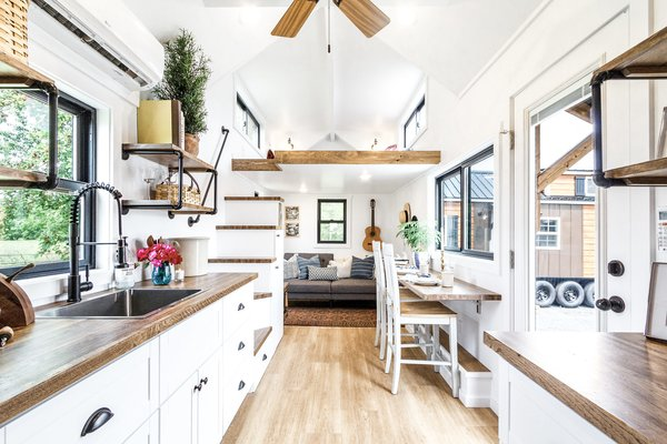 White-painted wood with medium-tone wood accents lend a fresh aesthetic to the Rumspringa model.