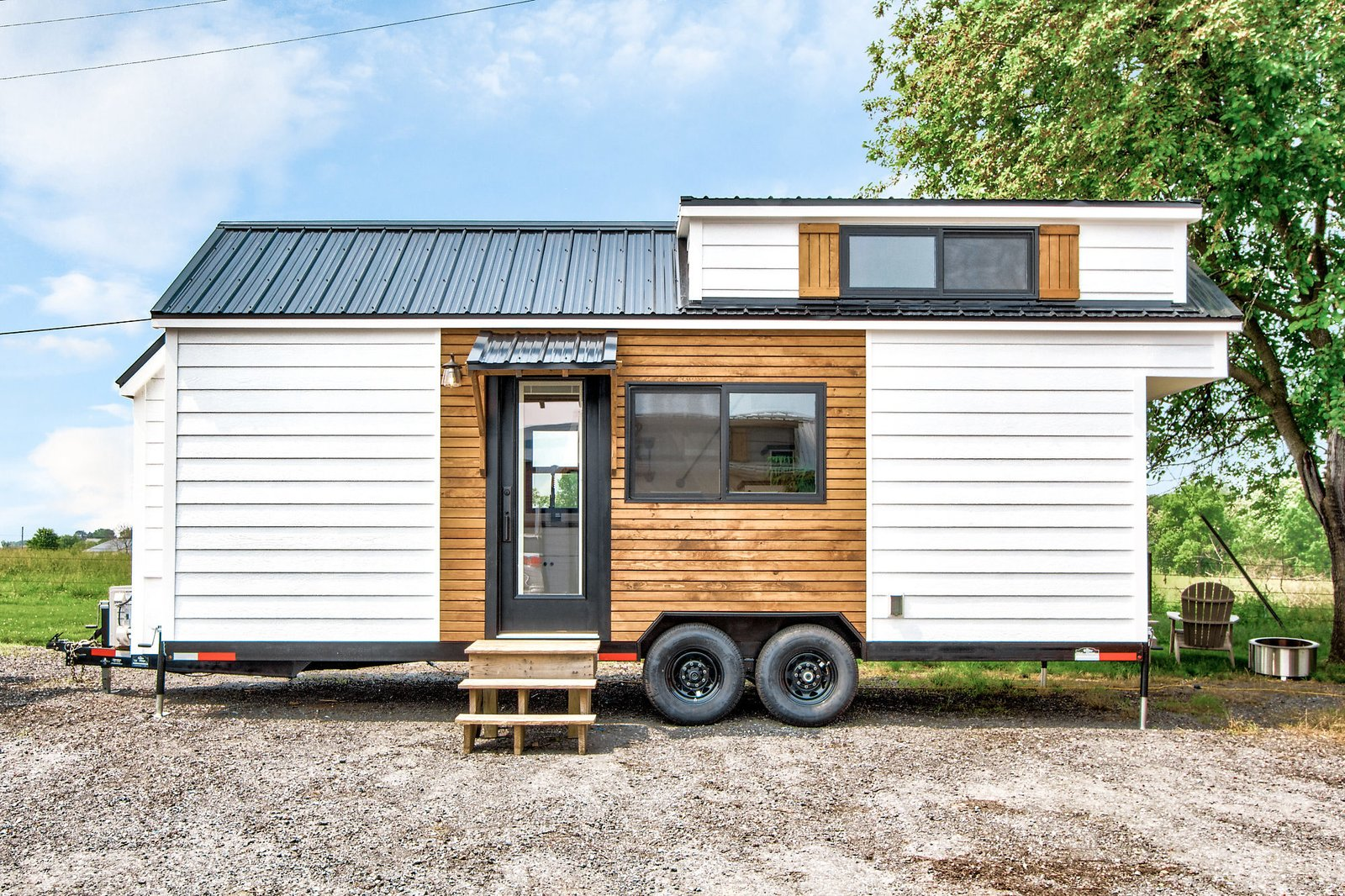 The Rumspringa is clad with wood siding and a galvanized metal roof.