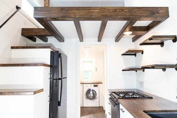 Espresso-colored wood accents and white-painted shiplap lend a crisp look to the interior of the Modern model.