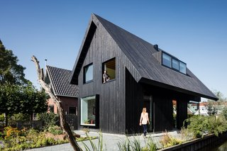 Exterior, House Building Type, Wood Siding Material, and Gable RoofLine The compact home is clad with wax-covered pine that's stained black. The architect employed an asymmetrical pitched roof with a dramatic overhang that helps to mitigate the sunlight that pours in through the large windows.
