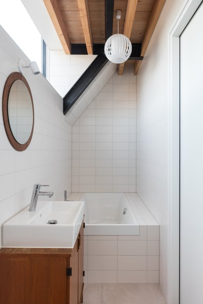 A clerestory harnesses natural light for the bath.