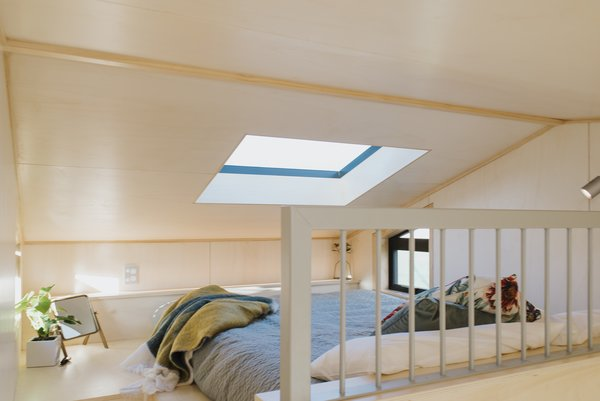 The loft-style bedroom is outfitted with a skylight that allows for stargazing at night.