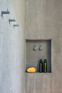 The showers, too, are crafted from smooth, poured-in-place concrete.