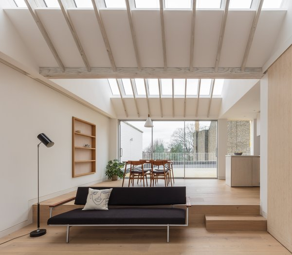 Skylights punctuate the ceiling, flooding the dining and living areas with natural light.