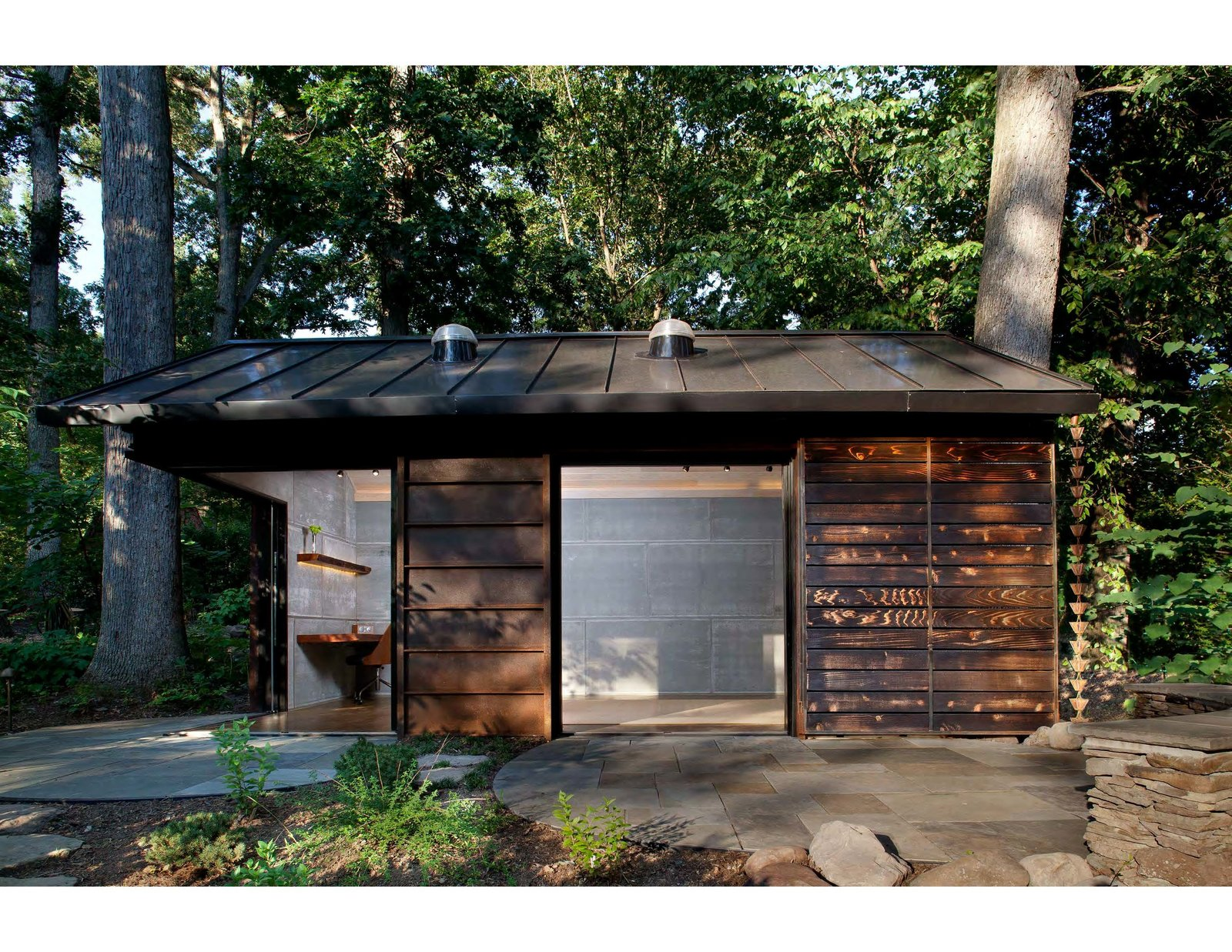 Exterior, Metal Siding Material, Cabin Building Type, Gable RoofLine, and Metal Roof Material GreenSpur and McAllister Architects imagined a cabin sided with Cor-Ten steel, glass, and shou sugi ban–treated cedar for a wooded property outside of Washington, DC.  Photos from Welcome to Your New Office, the Creative Cabin