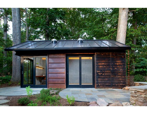 GreenSpur and McAllister Architects imagined a cabin sided with Cor-Ten steel, glass, and shou sugi ban-treated cedar for a wooded property outside of Washington D.C.