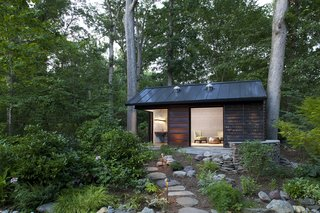 The architects situated the cabin between two old-growth oak trees so as not to disrupt the natural features of the site.
