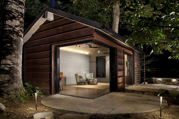 When the glass doors are pocketed, an entire corner of the building disappears and there's a feeling of being outdoors while working or spending time inside the cabin.