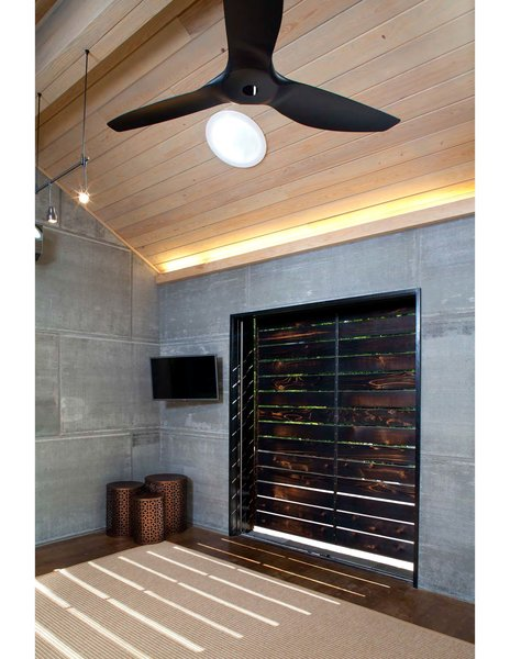 The slats of the cedar screens allow for light play on the interior.