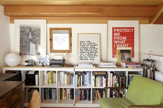 Office, Study Room Type, Medium Hardwood Floor, Desk, Chair, Bookcase, Lamps, Storage, and Shelves The upper-level office of Elysian Cottage by Bunch Design, where the materiality of the Douglas Fir ceiling has the most impact, takes on the feeling of a true cabin in the woods.